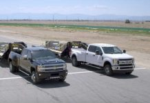 Chevrolet Silverado HD vs Ford Super DutyDrag Race With A Trailler 1