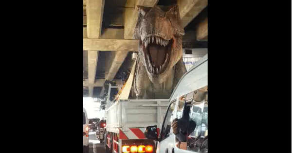 Extremely Realistic Dinosaur Model Driving In A Truck 1